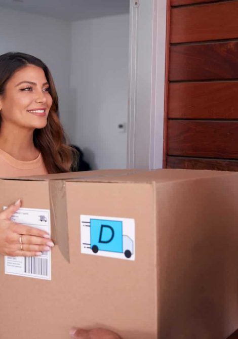 woman-receiving-package-delivered-by-courier